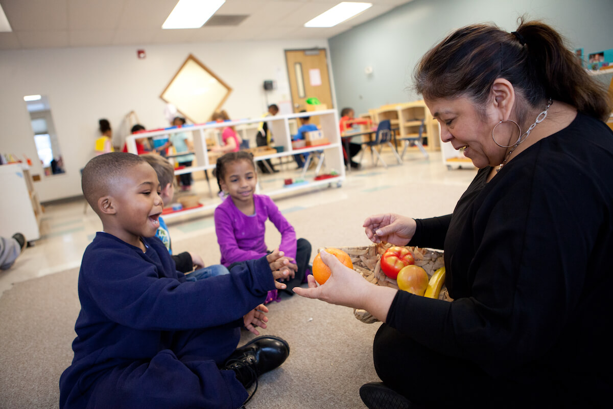 Miss Julia interacts with an MLK Montessori student. Miss Stacey is pictured at the top of the article.