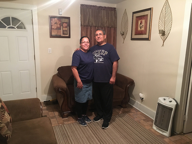 Margarita Rodriguez and her husband at their new home on Fabius Street. The Stand staff photo.