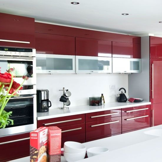 High Gloss - Thinking modern is more your style? Try a high gloss red with metal and glass accent cabinets and long pulls