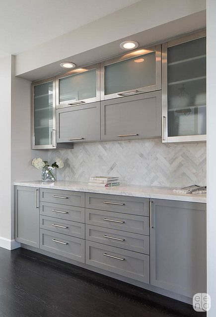 Sleek Modern - Try pairing gray cabinets with metal and glass accent cabinets to give your room a modern vibe.