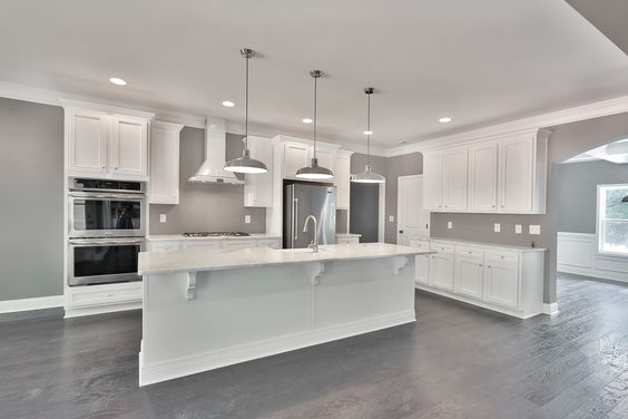 Wall Color - Paint your walls a beautiful gray to bring attention to a crisp clean white kitchen.