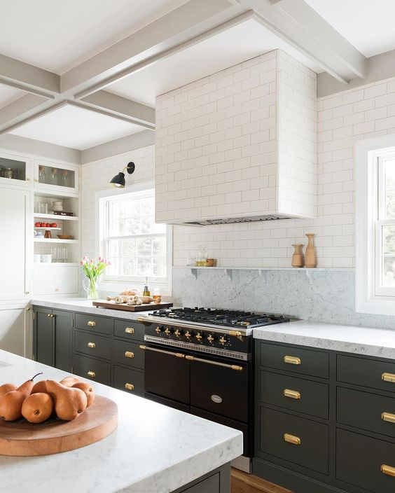 High Contrast - Go for a high contrasting room by doing upper cabinets in a white and base cabinets in a bold dark gray.