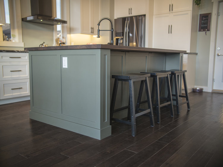 Green Island with Butcher Block Top and hidden cabinets