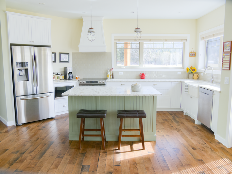 stunning white kitchen with accent green island with a country feel.png