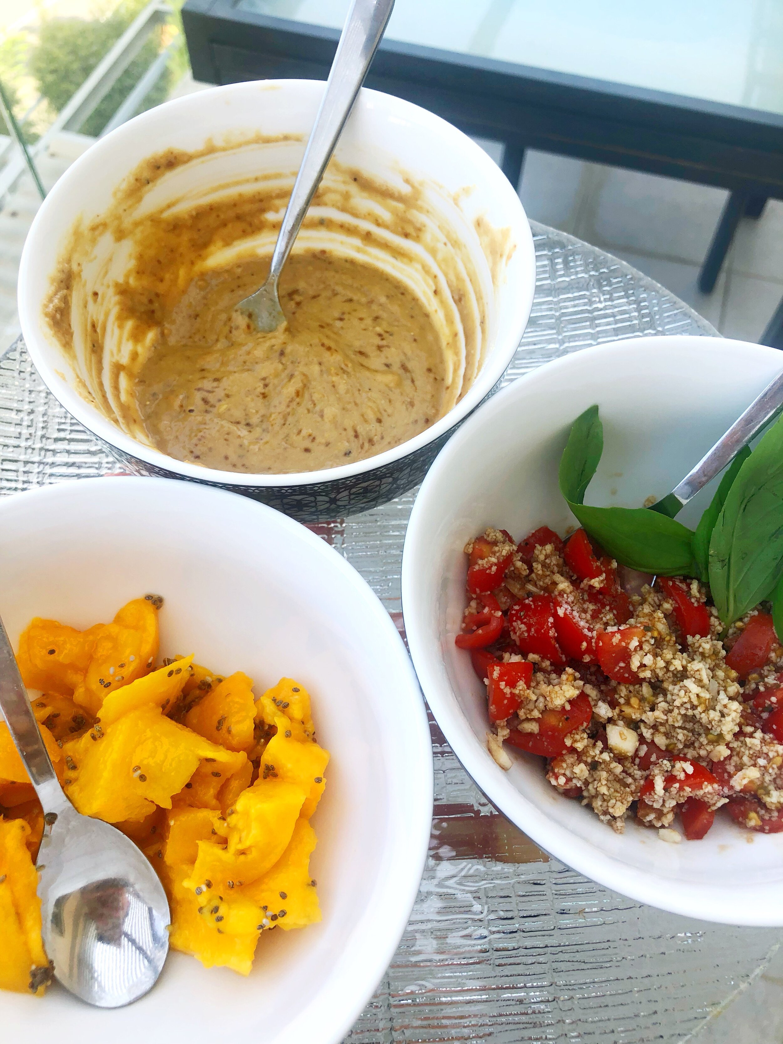 Sweet, Savory, Traditional - Sweet: Mango mashed with Chia Seed topped with RustysNuts Almond Butter with HalvaSavory: Homemade Peanut Butter Curry Dip with Slices of Cucumber + Peanuts (Recipe Below)Traditional: Tomatoes, Garlic, Dried Basil, Olive Oil + Balsamic Vinegar. Topped with fresh basil + Violife vegan cheese