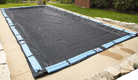 A generic tarp-covered in ground pool.  This is possibly the most-used image of a tarp cover found on the internet.