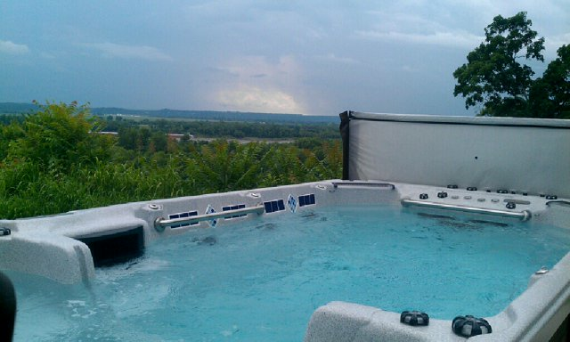 You can enjoy a scenic view of the Mississippi River in the summer (above) or a nice snowy day in the winter (left) when you own a hot tub.  Models Show: 16' Dual Temp (above)  12' Malibu (left)