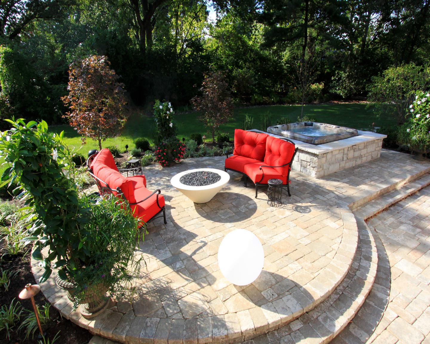 How about entertaining with a fire pit, lush green space and a hot tub in your backyard?
