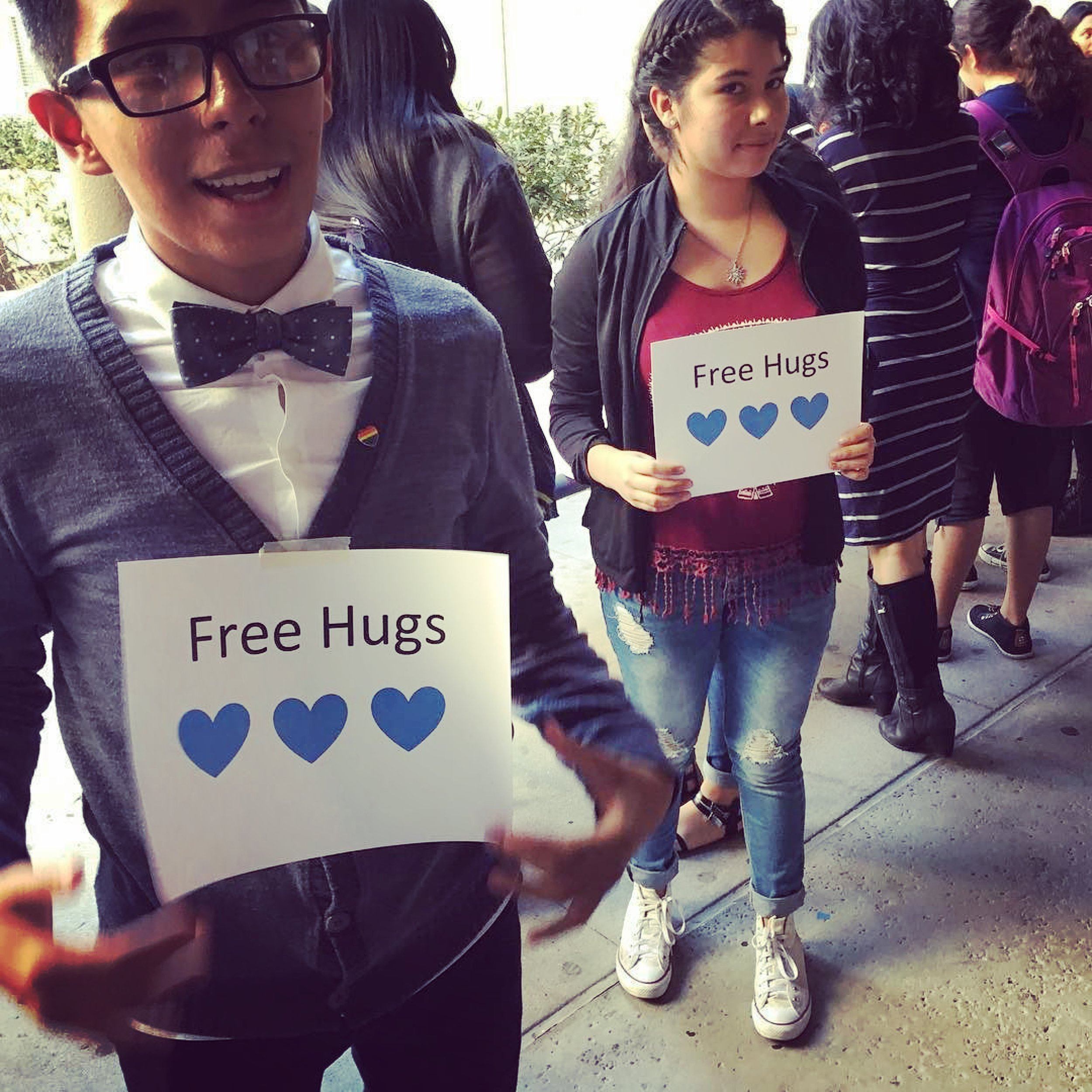 Humanitas Academy of Art &Technology (HAAT) students from Esteban E. Torres High School offer free hugs post-election.  Photo by:  @haatofficial