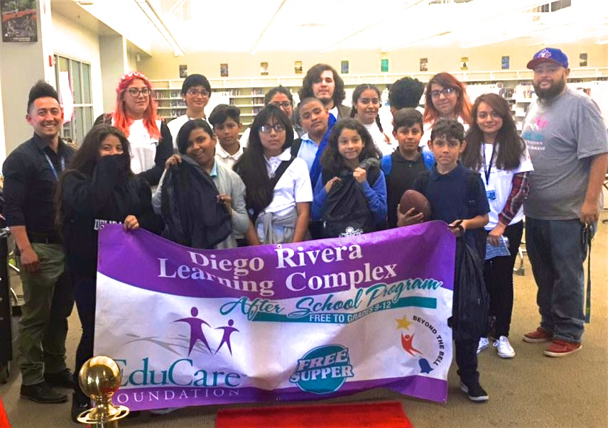 Students from Edison Middle School visit Diego Rivera Learning Complex to receive donated backpacks and school supplies.