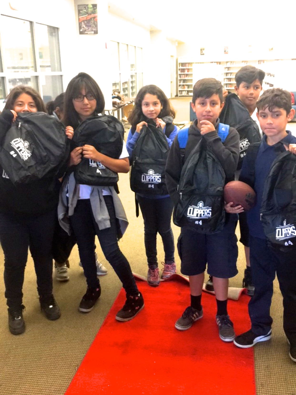 Edison Middle School students with their new LA Clippers backpacks!