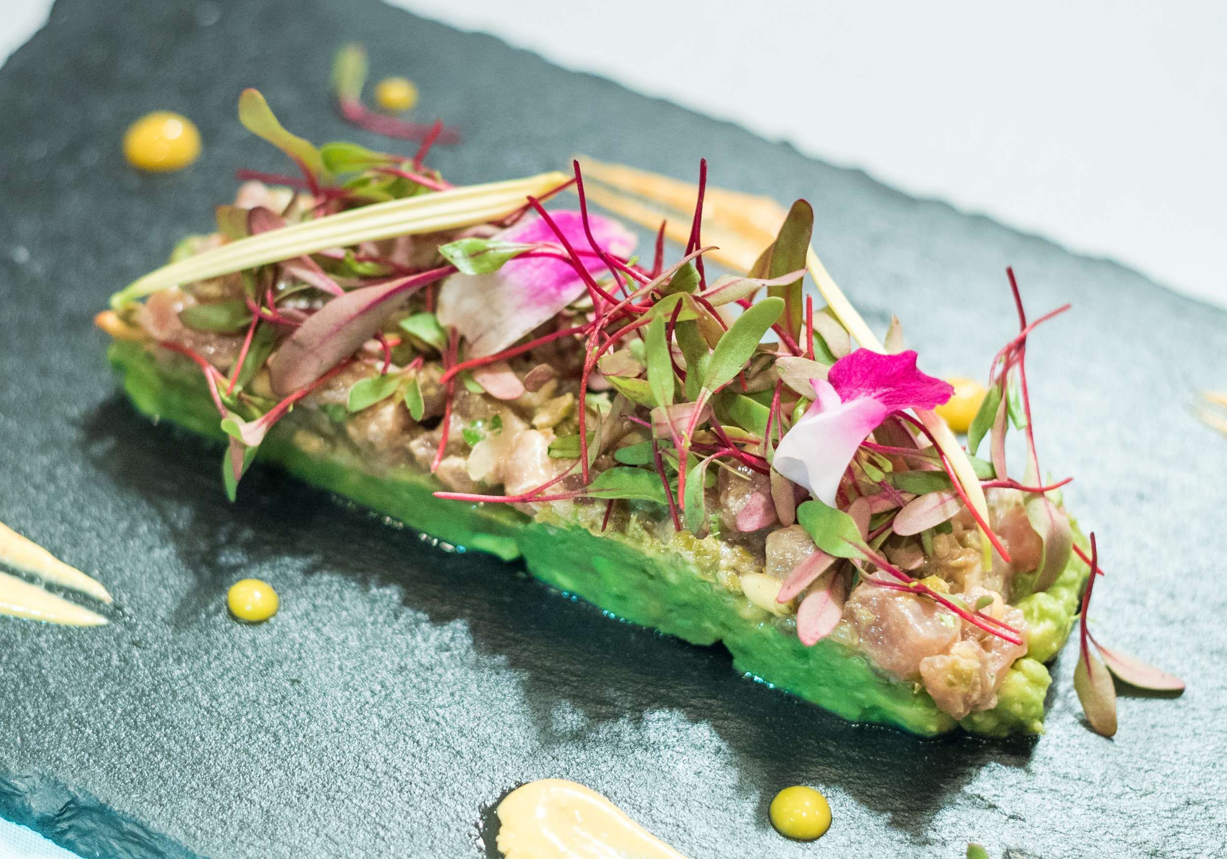 Mexican style tuna tartar with mashed sesame avocado and spicy mayonnaise.
