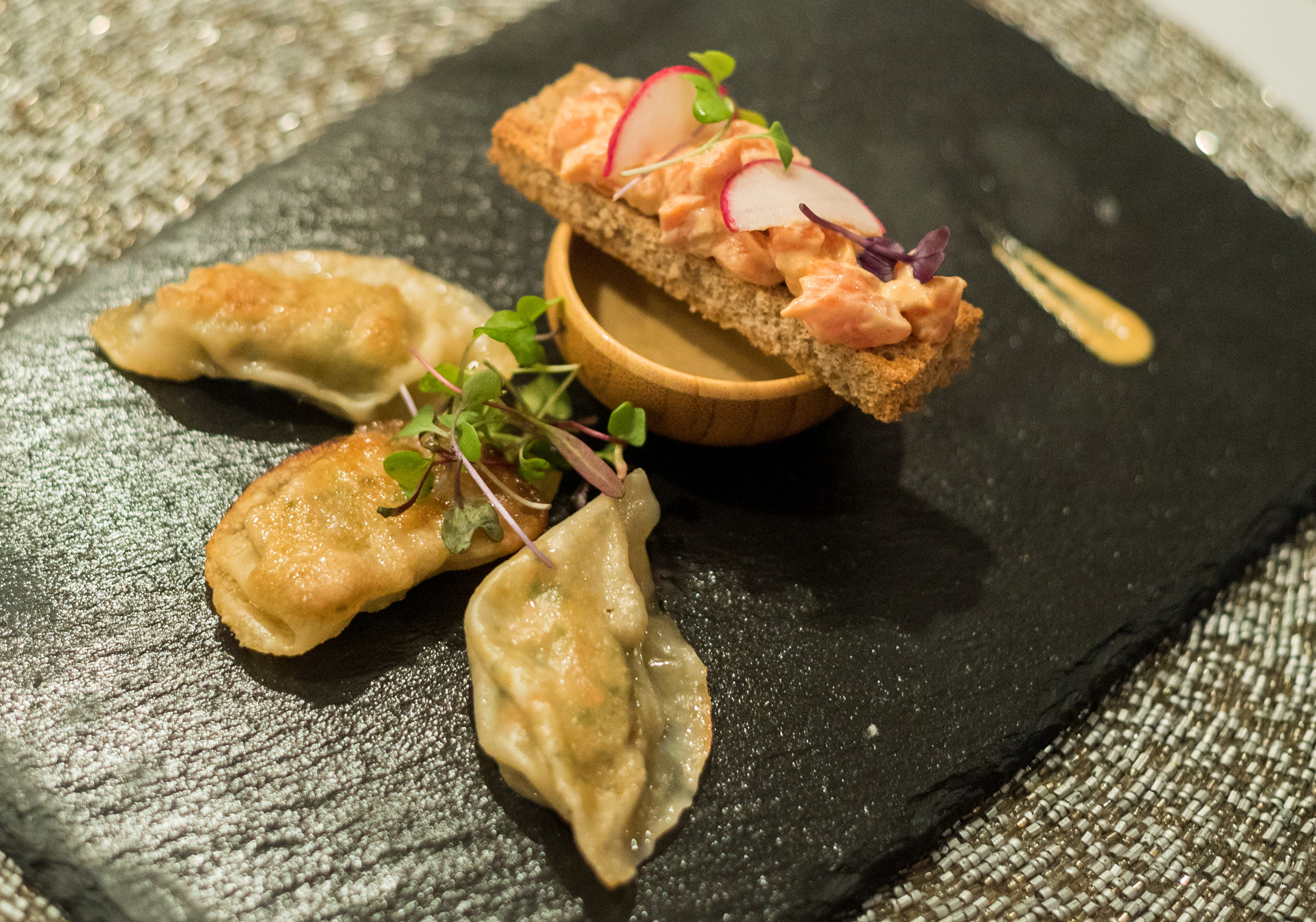 Shrimp gyosas with ponzu dipping sauce, salmon tartare crostini.