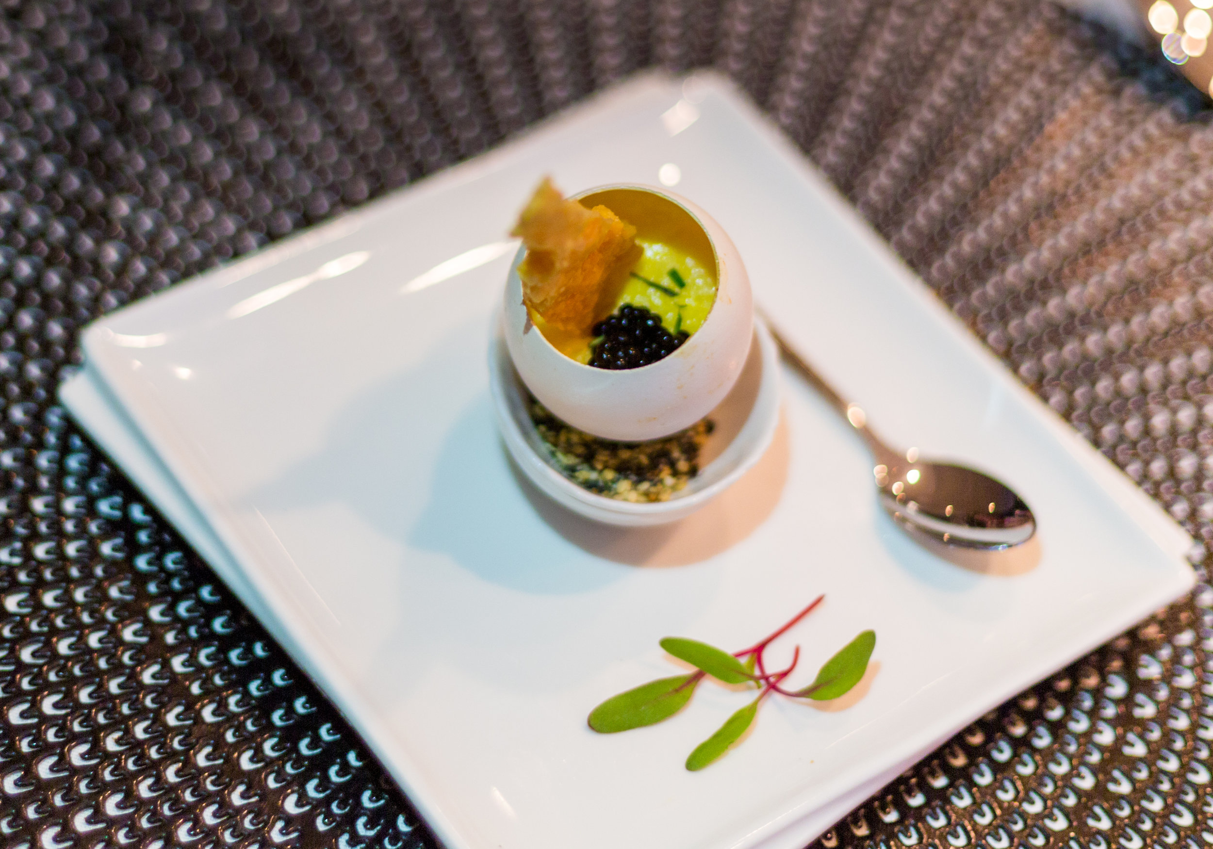 Eggs and bacon amuse bouche—egg custard flavored with bacon, slowly oven-cooked and topped with truffle pearls.