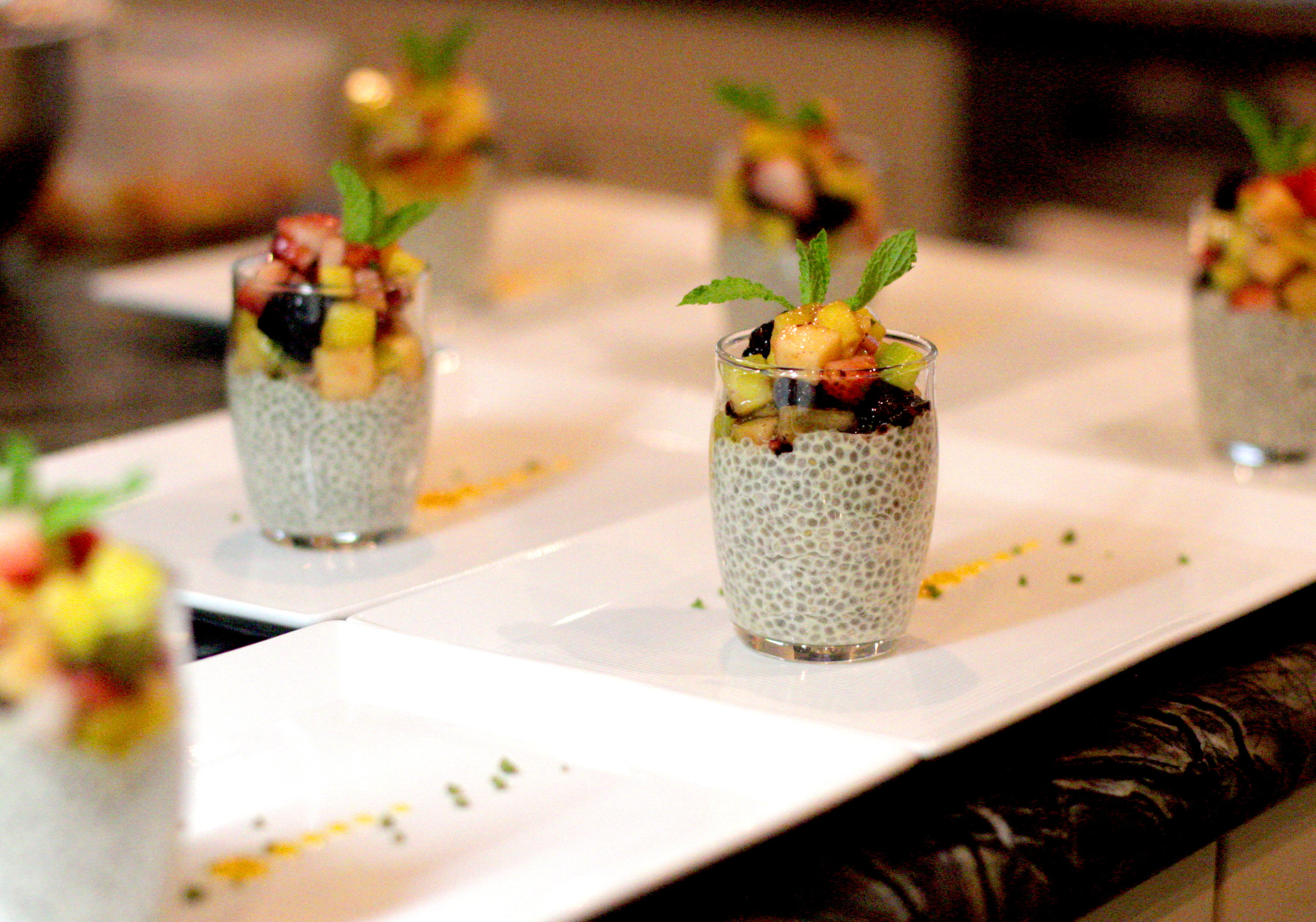 Chia seed pudding with mango coulis and seasonal fruit salpicon. A sugar-free healthy dessert alternative.