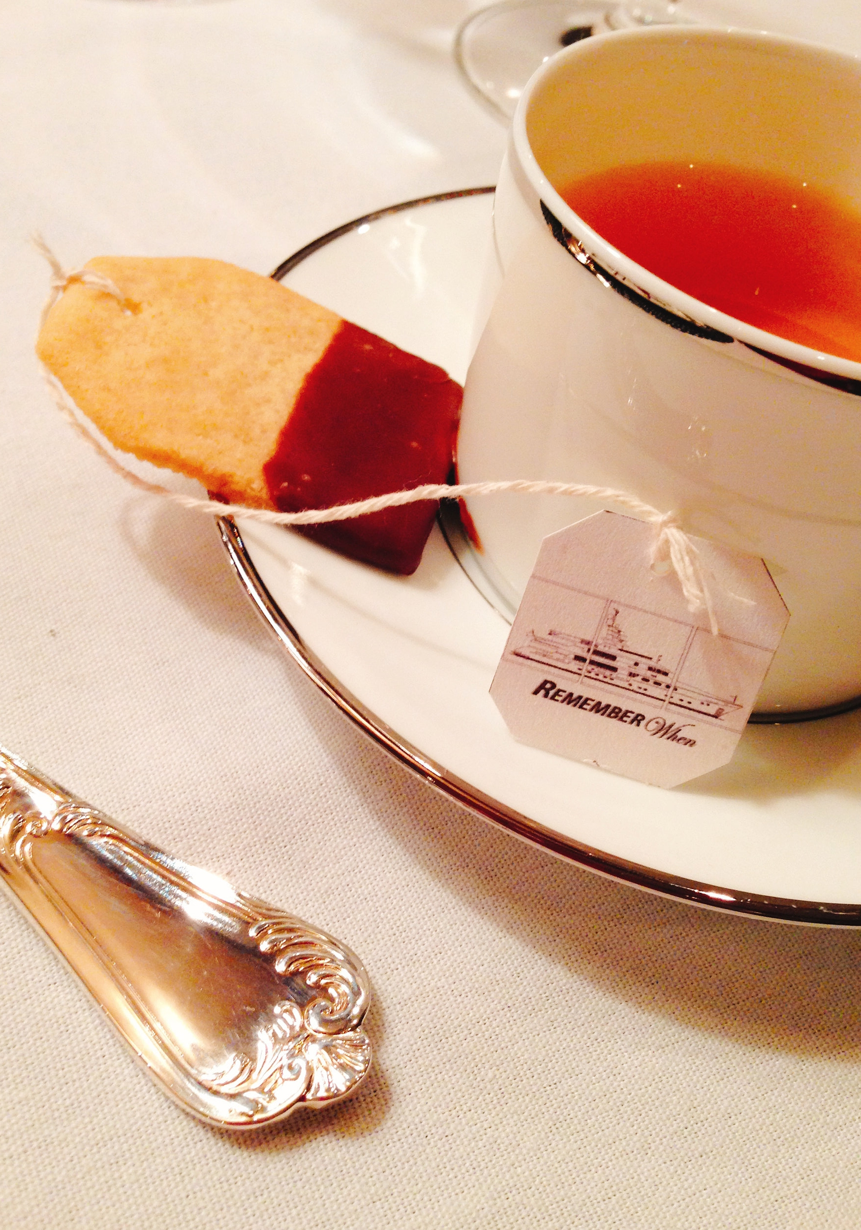 Tea time on Remember When with custom made tea-bag chocolate-dipped biscuits.
