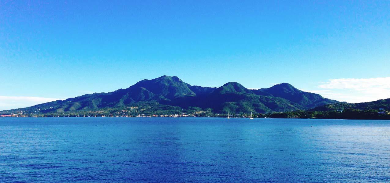 Dominica's luscious rugged terrain beckons Caribbean travelers.