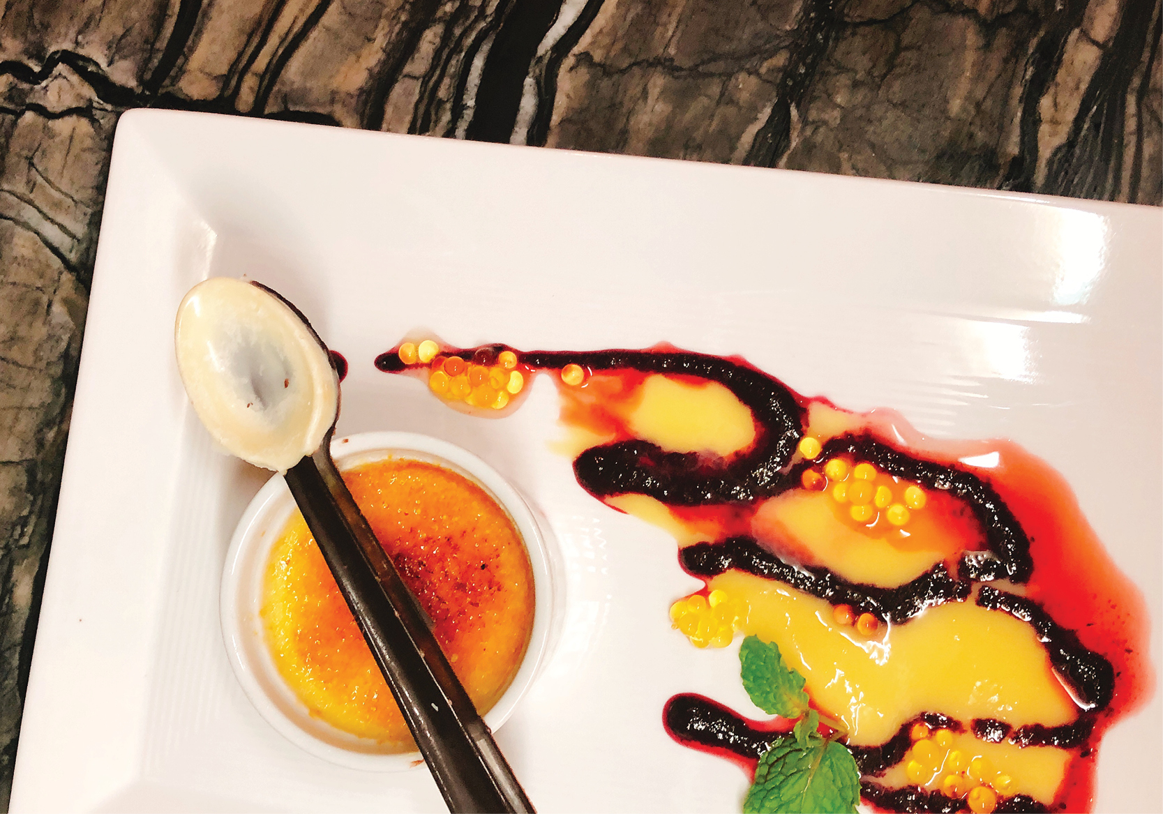 Crème Brûlée with Dark and White Chocolate Scooping Spoon