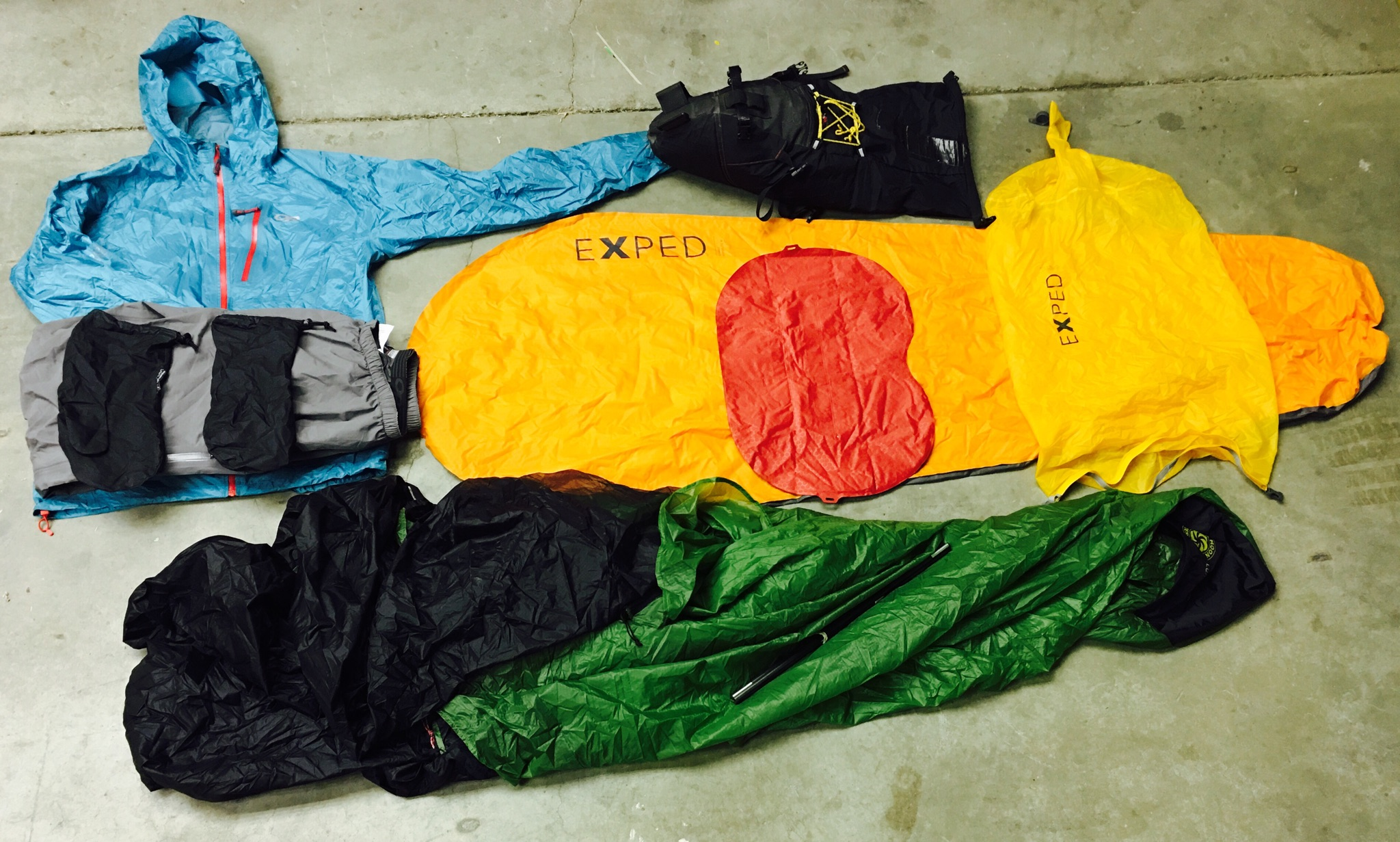 Revelate Designs Viscacha Seat Bag  Contents:  Rain Gear - OR Helium II jacket, OR foray pants, MLD Rain Mitts  Six Moon Design Lunar Solo Tent w/ Easton Carbon Fiber Pole  Exped Synat Hyperlite sleeping pad, Exped pillow, Exped Schnozzel air pump/drybag