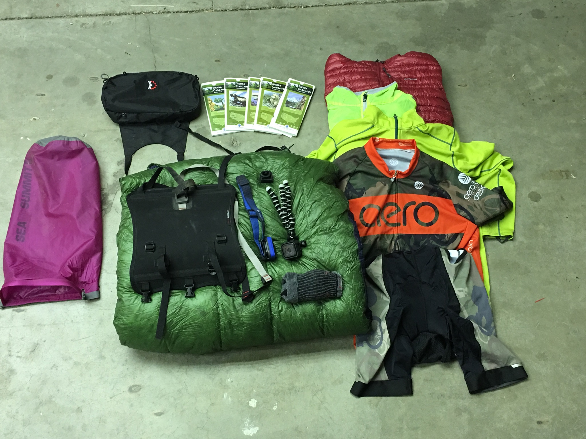 Revelate Designs Harness and Pocket.  Stuff Sack Content:  Clothes- Patagonia Ultra Light Down Coat, Patagonia Capoline Long Sleeve, Aerotech Designs Jersey and Bibs, and Darn Tough Cool Max socks  Sleeping Bag- 10 degree Revelation Quilt by Enlightened Equipment.  Pocket Content: Black Diamond Spot headlamp, GoPro Hero4 and mini tripod ( Thanks Mom and Dad!!), and the Adventure Cycling Association Sierra Cascade Route map set.  There is also plenty of room left in the pocket for an entire package of mini-snickers bars.