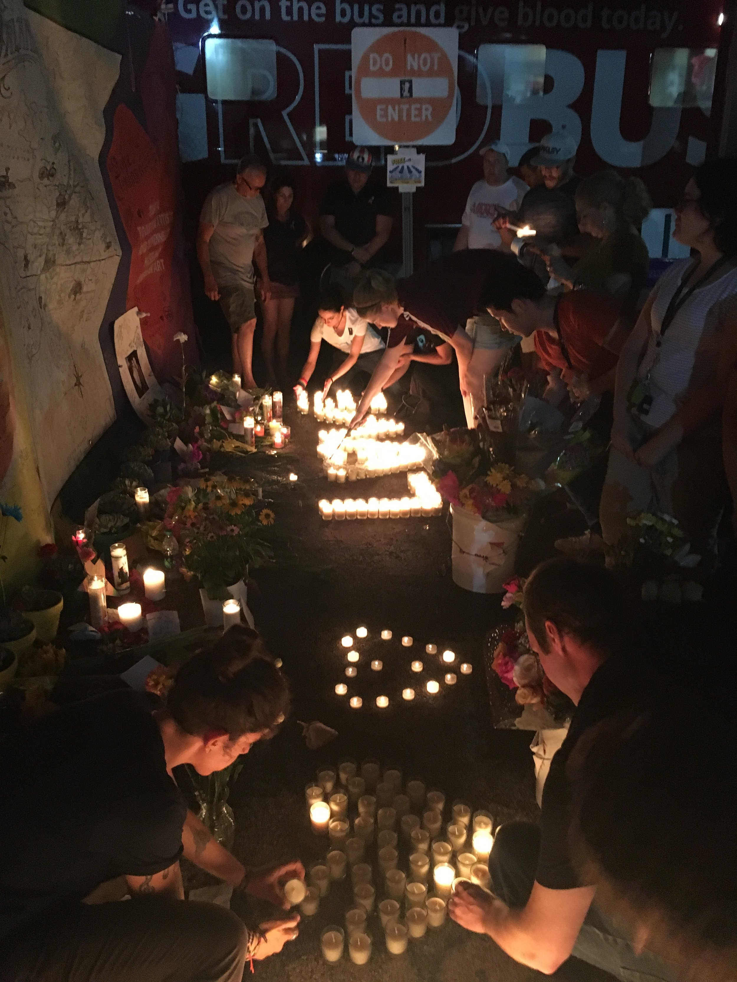 Pictured Above: Our team at the Pulse Nightclub arranging candles in remembrance of the victims