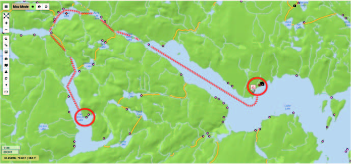 Paddling for plants - Our route from Cedar Lake to Carl Wilson Lake spanned 4 lakes and 3 portages, ending with spectacular cliff faces…and swarms of black flies.