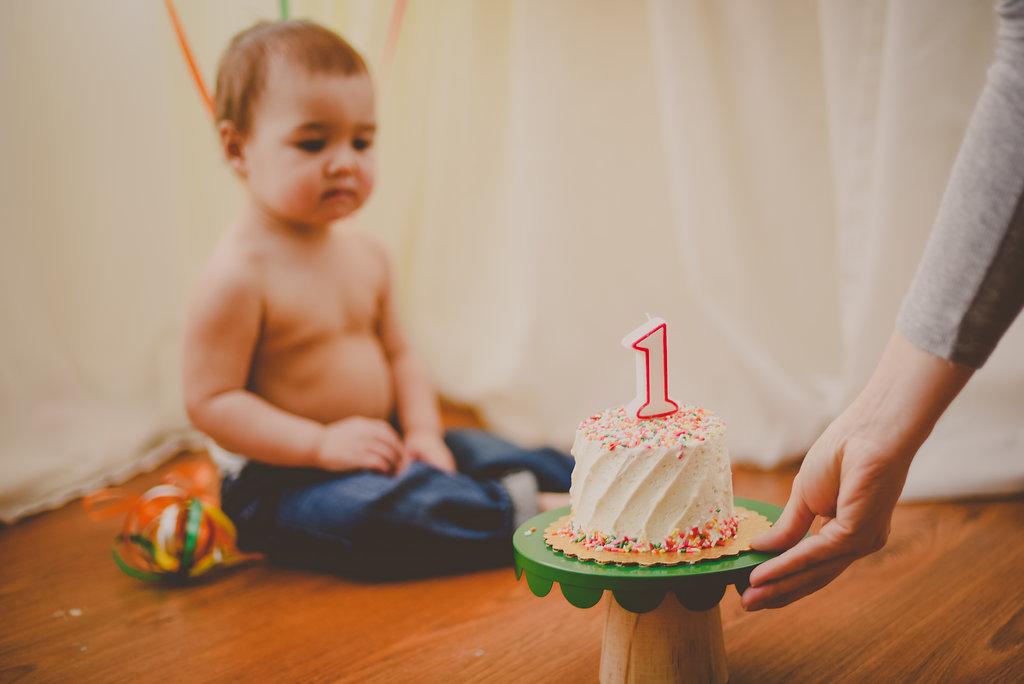 Colorful, sprinkle themed first birthday cake smash // AUburn Syracuse Skaneateles New York