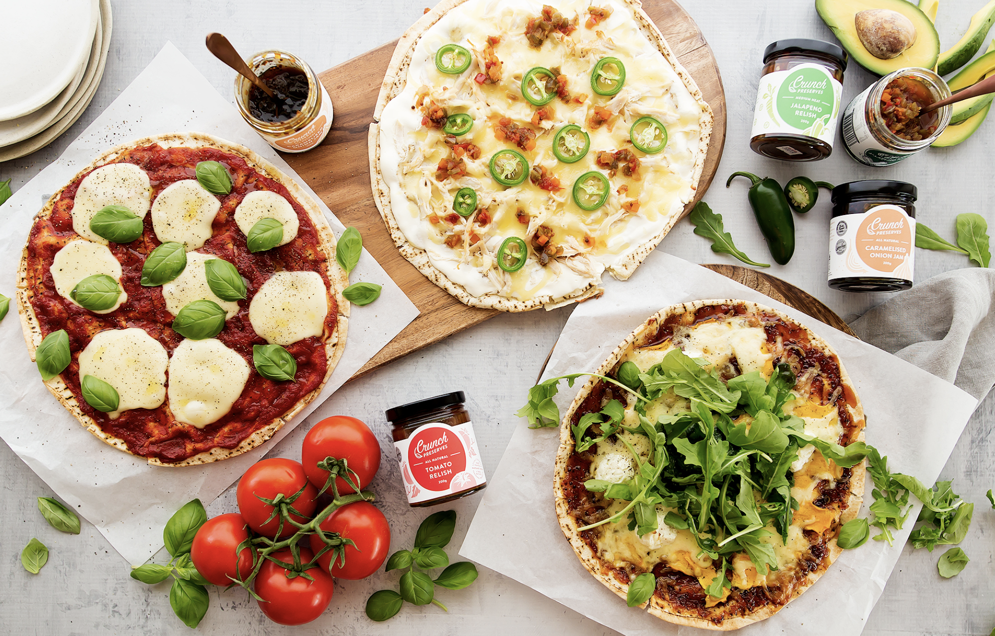 Crunch Preserves 3 Easy Gourmet Pizza Recipes:  Chicken & Jalapeno Relish with White Sauce  Tomato Relish with Mozzarella & Basil  Pumpkin, Caramelised Onion & Goat's Cheese