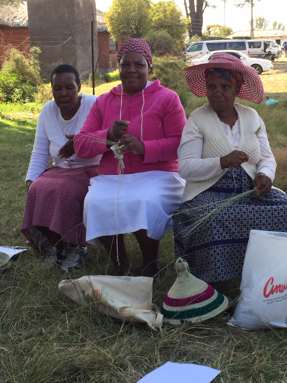 Making and chatting often go hand in hand. Basket makers in Butha Butha Lesotho