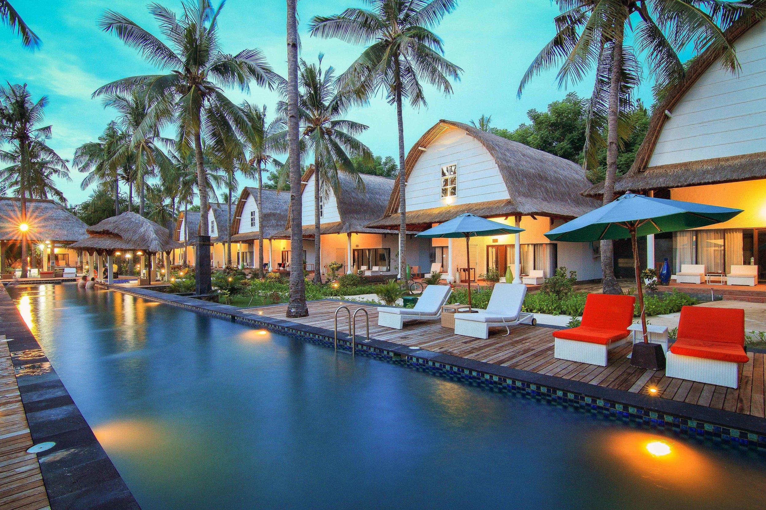 Jambuluwuk Oceano Resort Pool and Rooms Night View.jpg