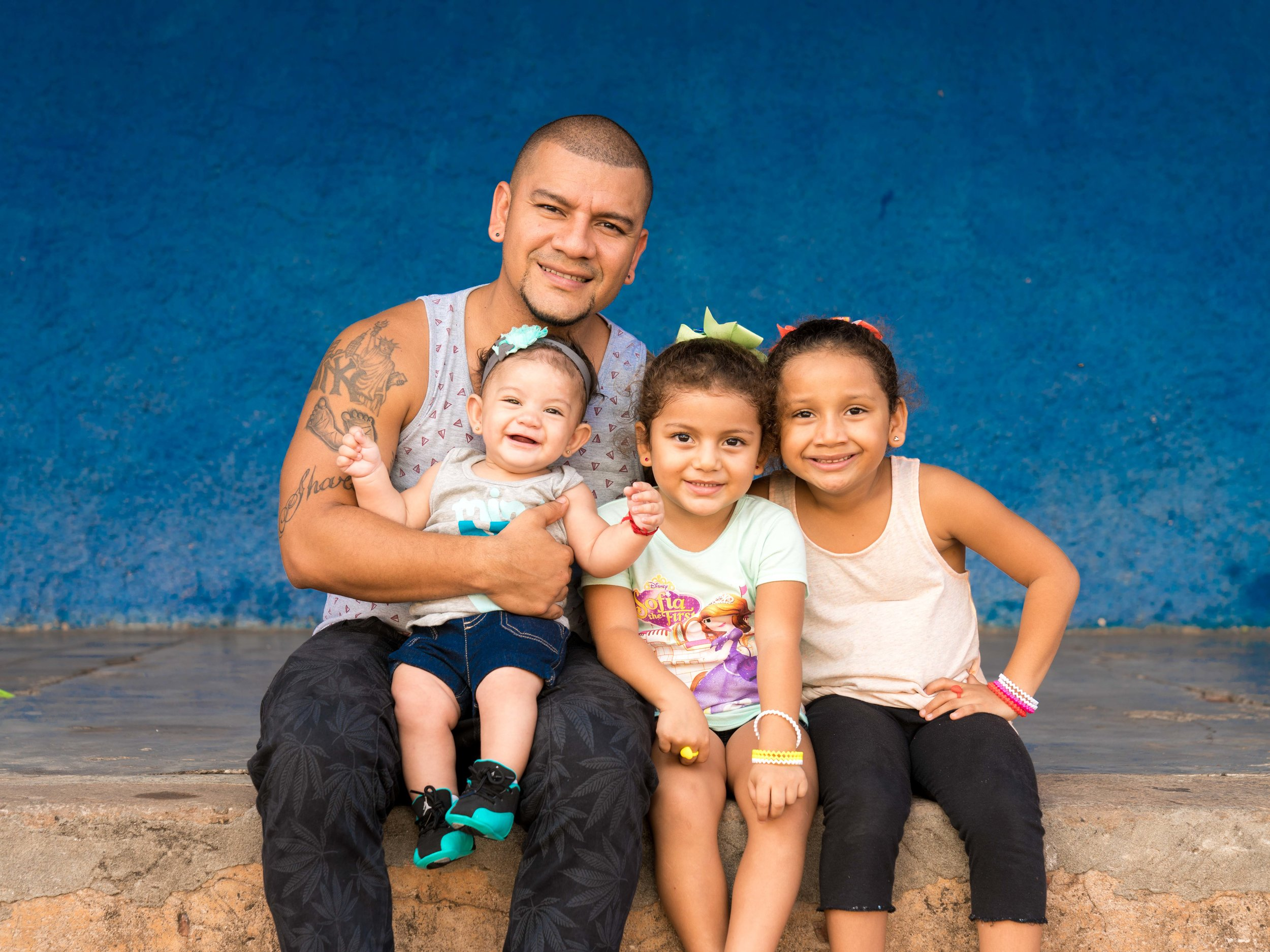 Orlando is a tough man, but as soon as he started talking about his girls (his eyes softened and he called them his little angels) I knew I had to make a portrait for them. Here he is with his girls Sharon, Emily and Jennifer.