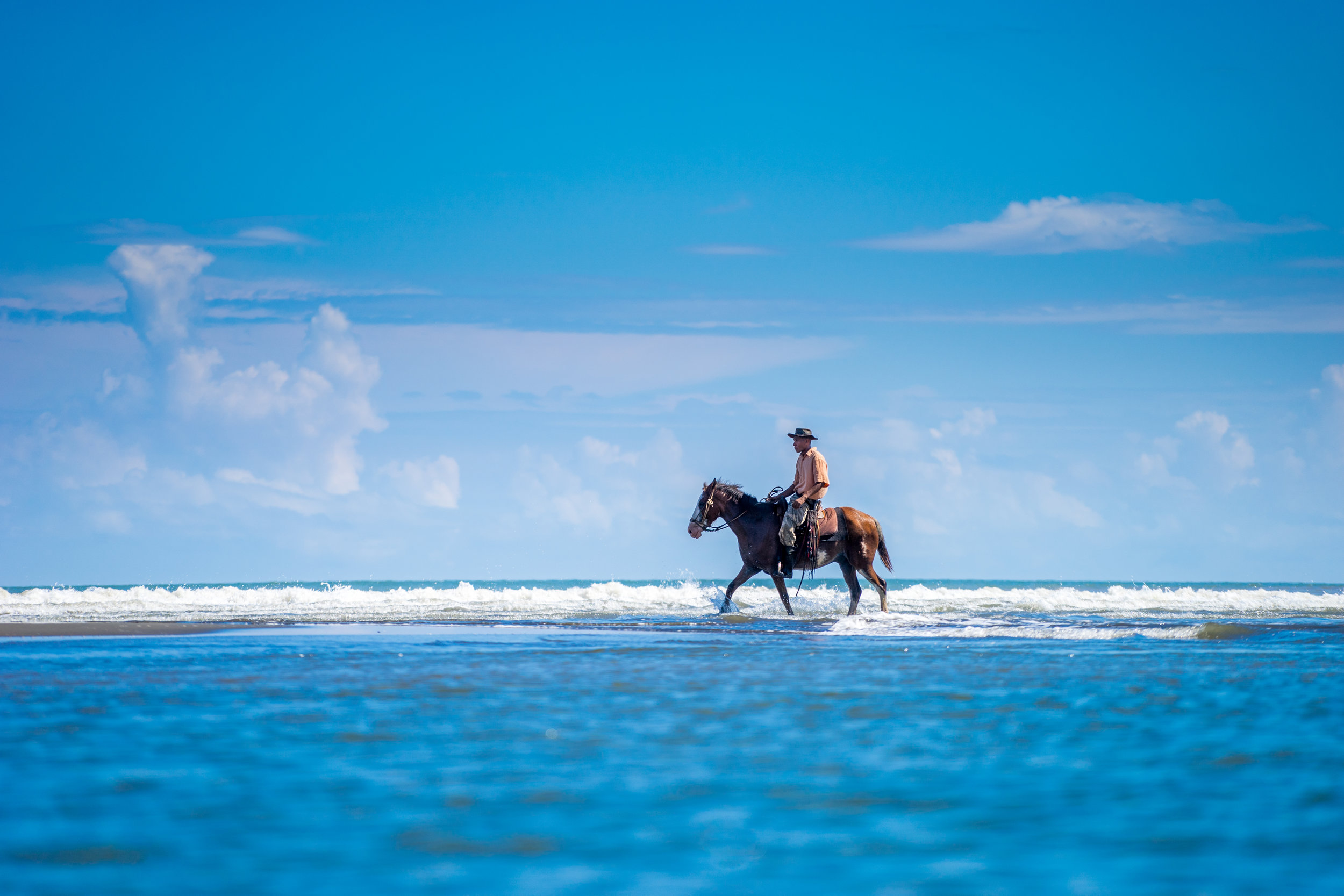 Man on horseback on the Caribbean