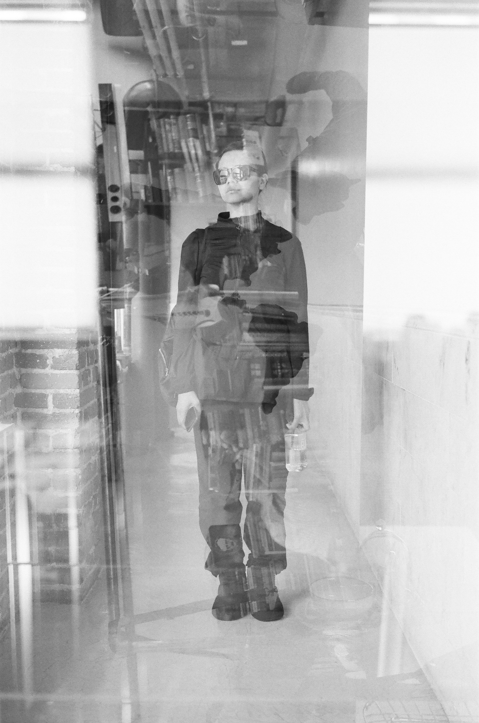 Accidental psychological portrait of my wife. Her, a map of the world, her books, teacups, unicorn statues, a ballet bar, and other random things she collects. Leica M-A, Summicron 50mm 2.0, Ilford Delta ISO400 35mm film, multiple exposures.
