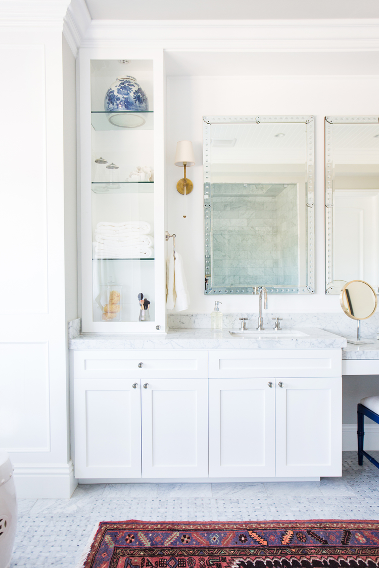 White+Bathroom+Cabinetry,+brass+sconces,+marble+floors+--+Studio+McGee.jpg