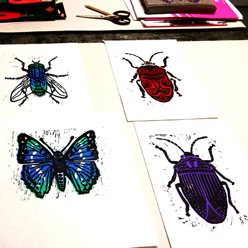 Colour linocuts - - Create your own two colour design- Learn cutting techniques, register colour layers and print.Workshops subject matter can be themed to reflect current or future projects.Cutting tools used so not suitable for younger students.(Prints from class at my 'Butterflies, Bugs and Beetles' workshop at Digswell Arts 'Forge' studios)