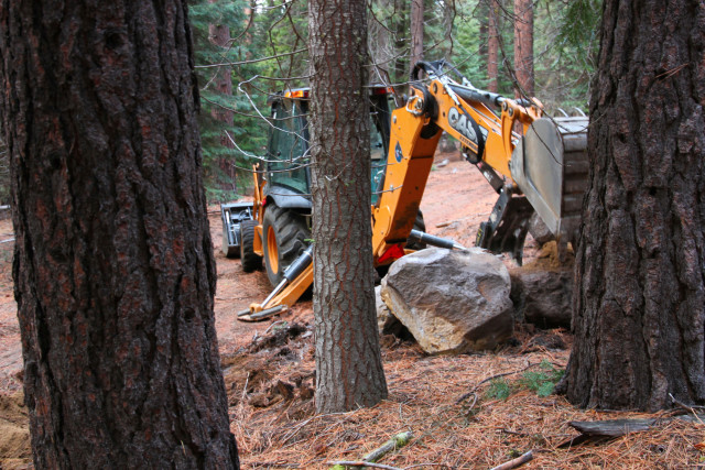 The Forest Service began work to repair erosion and other road damage in the fall of 2015. The total cost for rehabilitation is expected to come to $200,000. Here, a road crew moves boulders into place along one of the damaged roads.