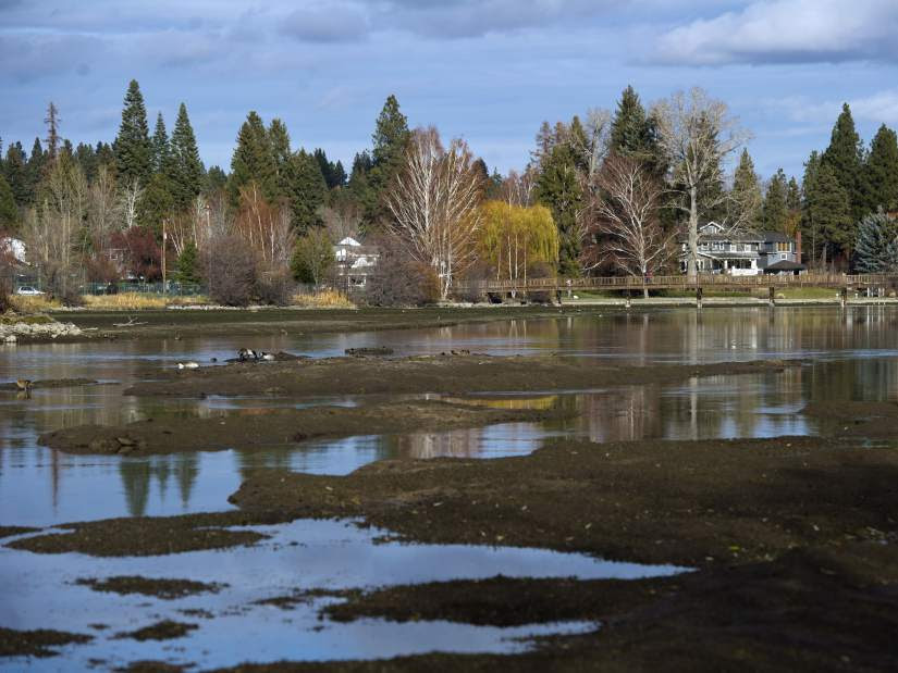Photo: Ryan Brennecke / The Bulletin.An area of large mudflats in Mirror Pond are exposed Wednesday afternoon because of low water