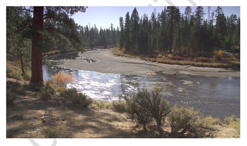 The river in the same location as the first picture, showing dramatic changes in water levels