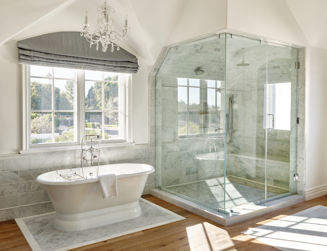 The muted grey's in the Carrera marble along with grey linen shades create a soothing retreat.