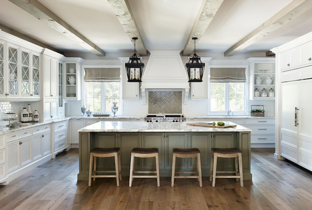 The laundry room carries the theme from the kitchen and features a farmhouse sink.