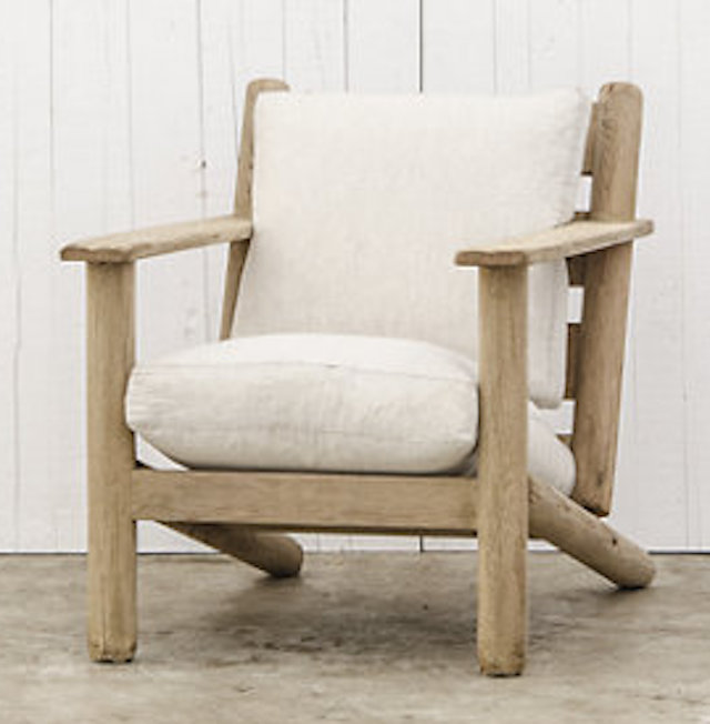 We also love      Ralph Lauren 's   Post and Lintel Chair and Ottoman in white shearling. Really beautifully simple.