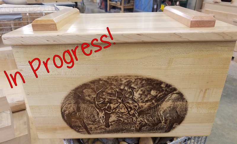 Ammo box with elk fight engraving for raffle