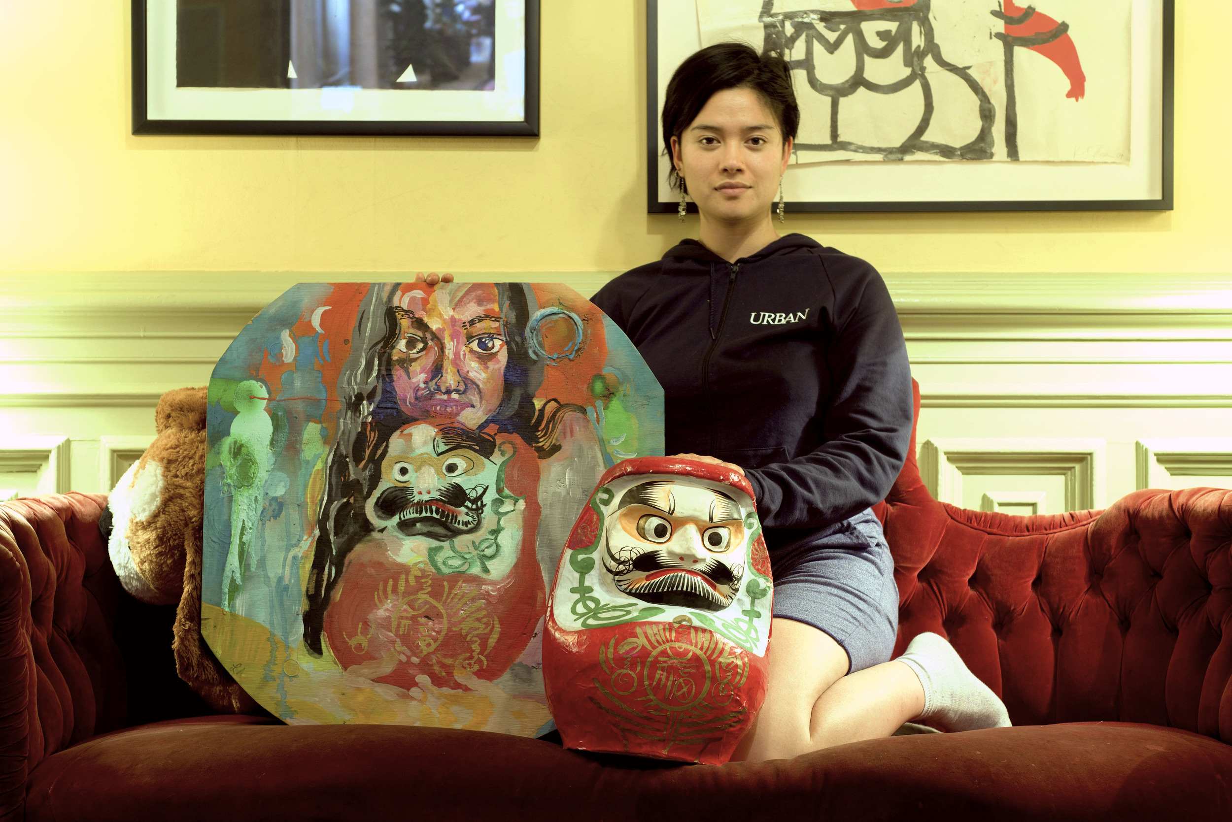 the model Natasha Tamate Weiss posing with her daruma doll and the original copy of the Lemon of Pink (photographs taken by Dat Vu)