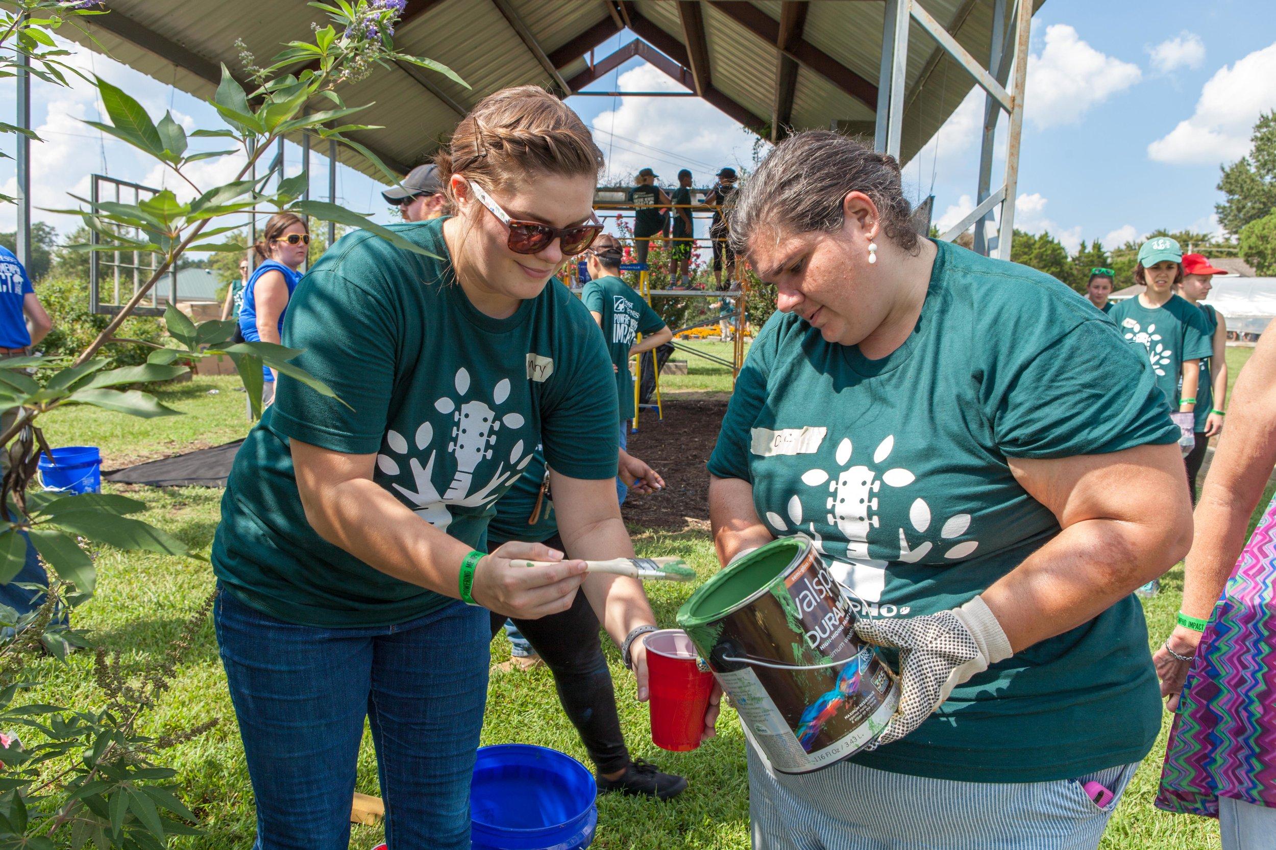 Environment-Volunteers-Pouring-Paint-MEMPHO.jpg