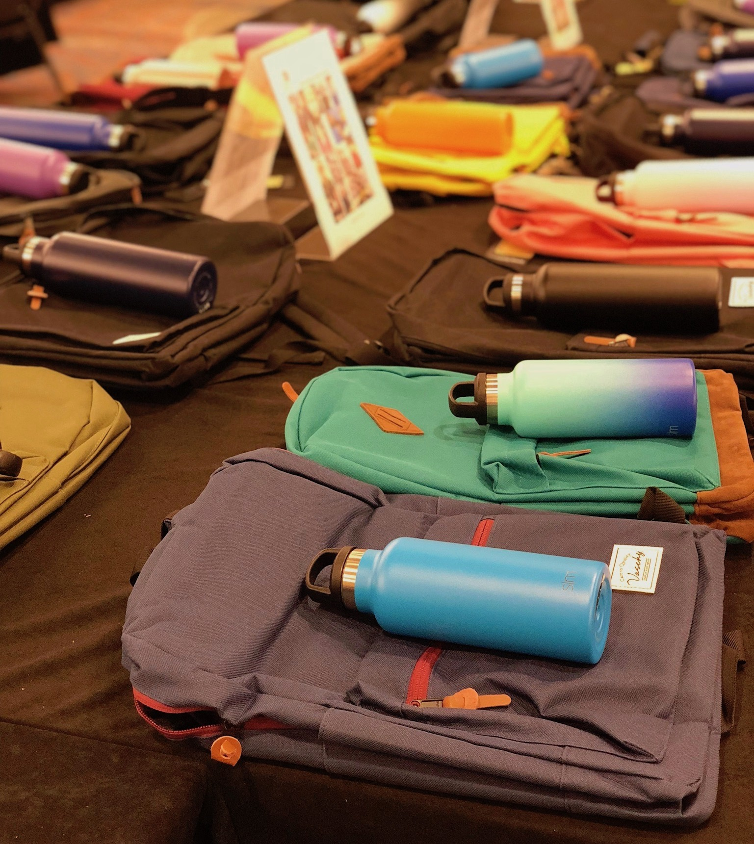 Meeting attendees in Denver recently filled backpacks with all of the items that children would need to start their school year successfully.
