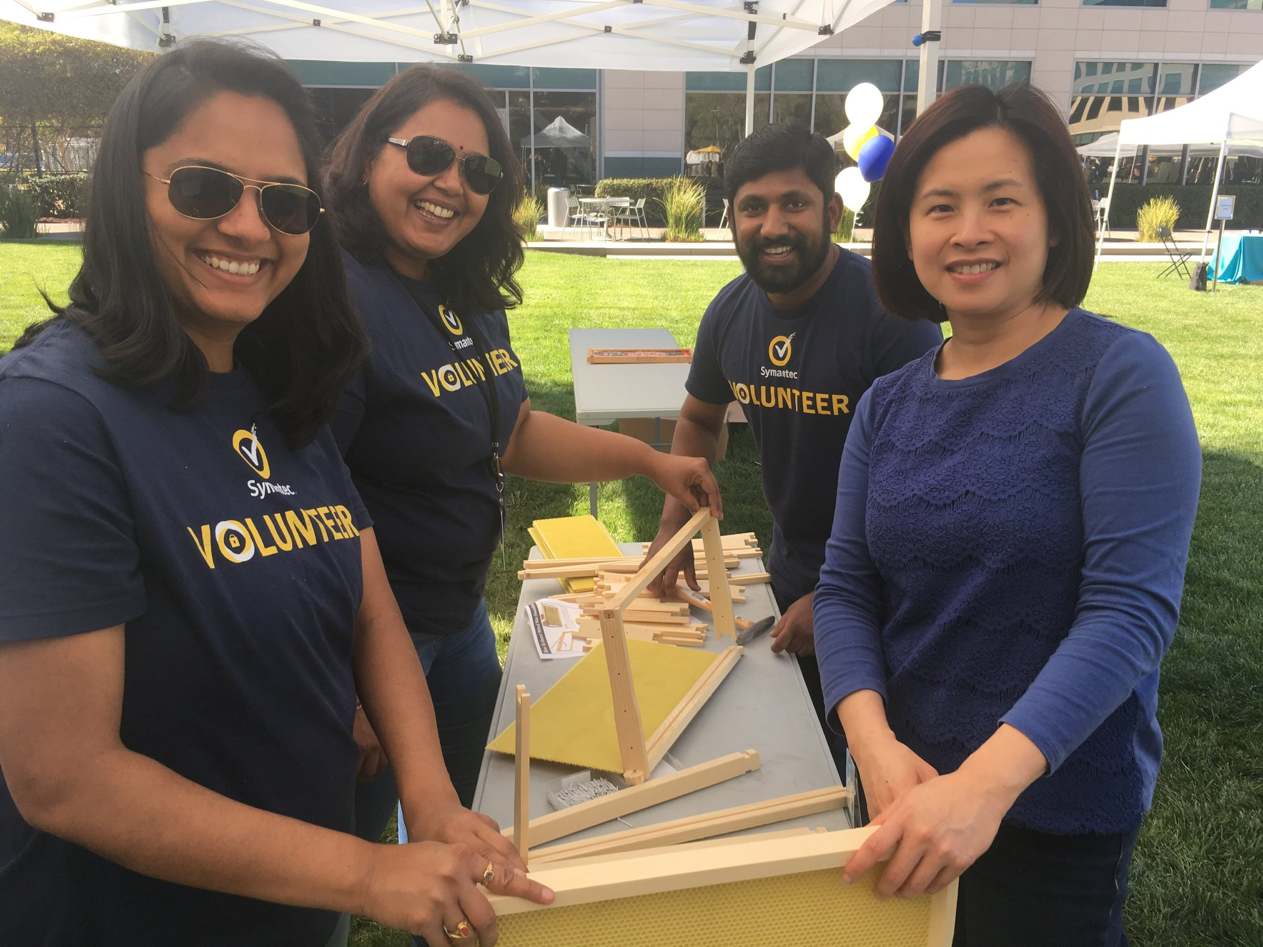 Volunteers at Symantec's headquarters in Mountain View, California, paused for a picture while they were putting together bee hotels for the Planet Bee Foundation.