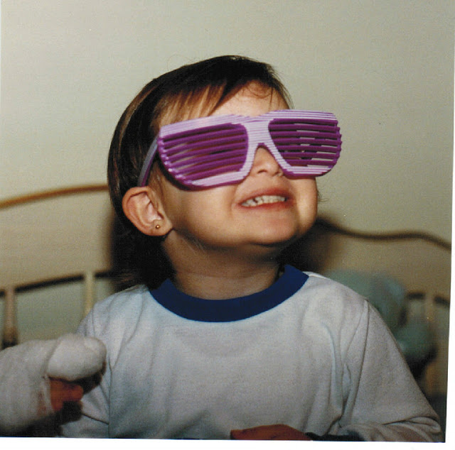Accessories were an important addition from a very early age. As was my typical, cheesy grin. Life is best lived happily and in sunglasses!