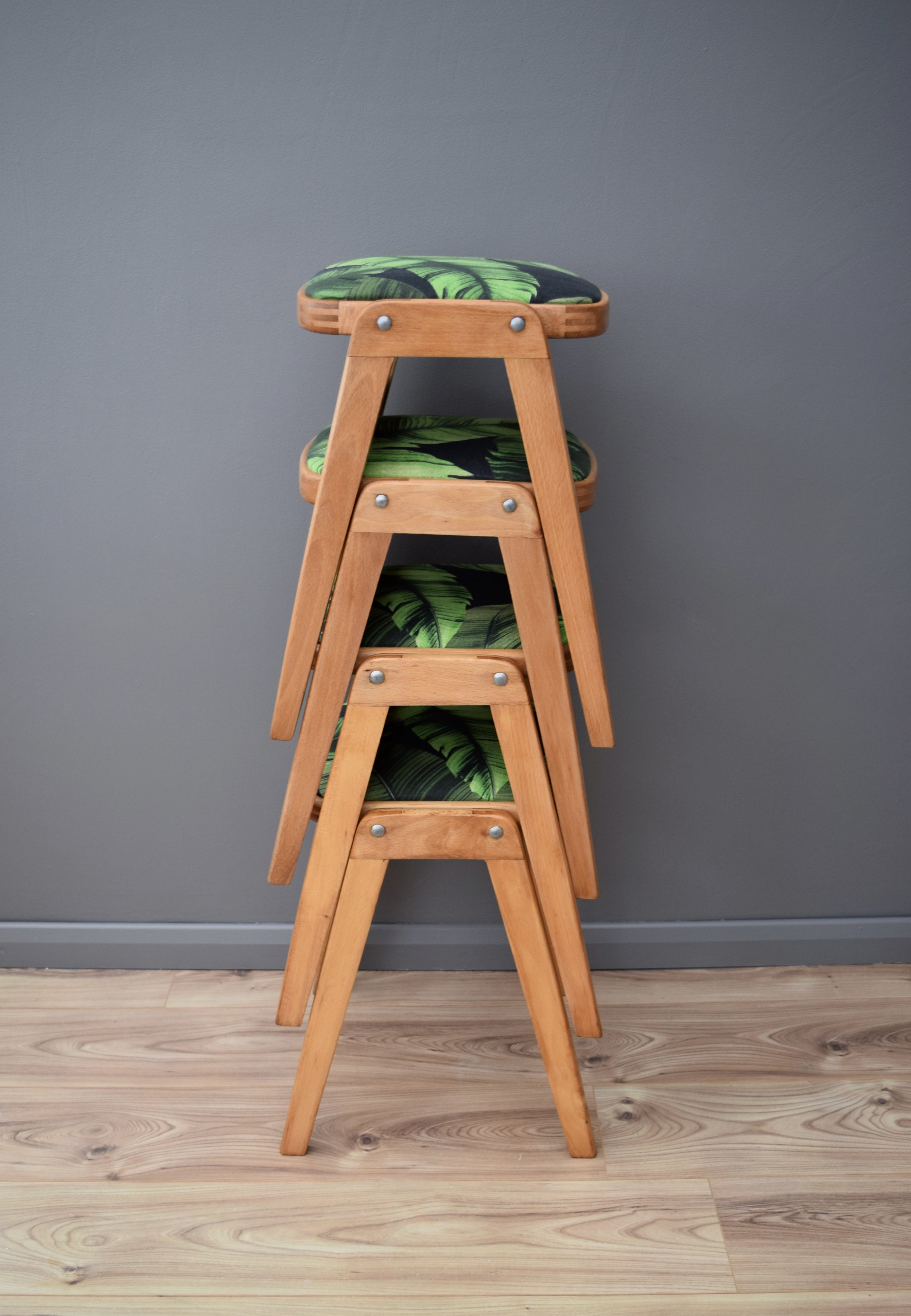 MID-CENTURY STACKING STOOLS WITH PALM UPHOLSTERY