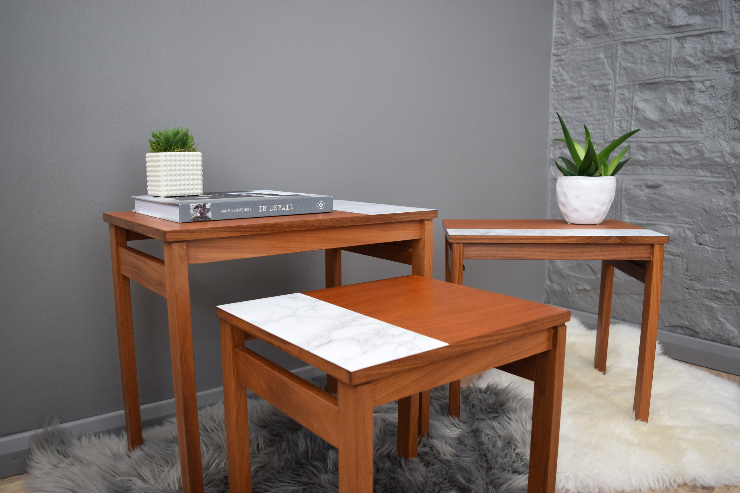 TEAK NEST OF TABLES WITH MARBLE DESIGN