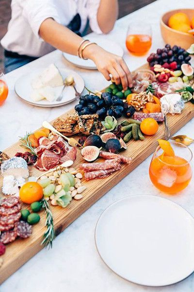 I love to entertain, but lets face it we all have busy schedules. My go to for anyone dropping by last minute, or Friday family cocktail hour is the charcuterie. I fill with anything I have in the house. For me dried fruit is usually a staple, some form of cheese, nuts, olives, crackers or a quick bruschetta do the trick nicely. A drink or a glass of wine and in minutes you have something quick and easy to serve.    With the imminent snow coming tonight I am thinking of warmer times by the pool and hoping spring is just around the corner.  Image via Lonny.com